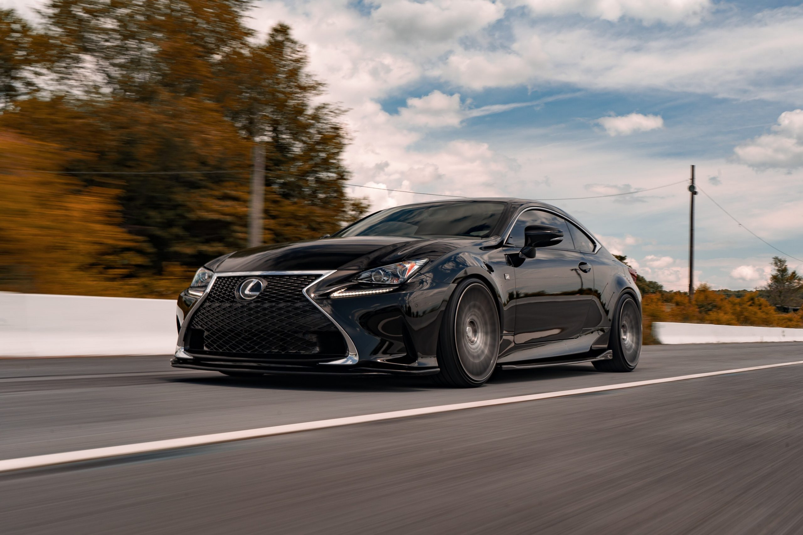 black Lexus driving on road